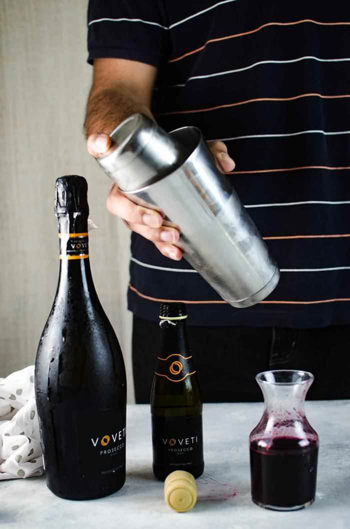 Sparkling Blueberry elderflower sour - This prosecco cocktail is a cross between a mimosa, and a whiskey sour. Shake it up with some ice.