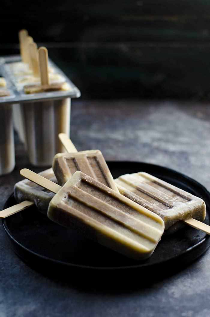 Vanilla and Chocolate Protein Popsicles - These taste like a decadent summer treat with those delicious vanilla and chocolate swirled layers, but they have no added sugar, they are vegan and gluten free, and loaded with protein! A fantastic post work out snack or any time of the day snack for you or kids!