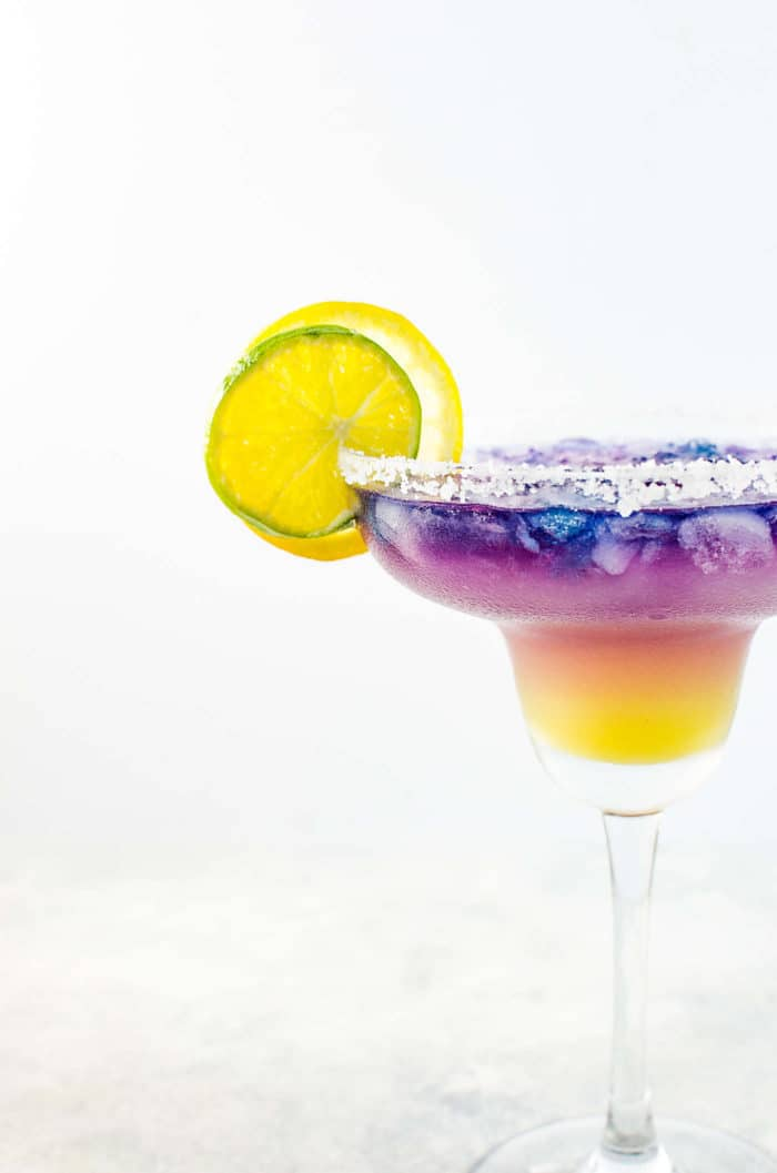Magical Color Changing Cocktail - A Color changing Margarita that reminds you of the sunset! Tastes amazing and look magical and made with Blue Pea Tequila