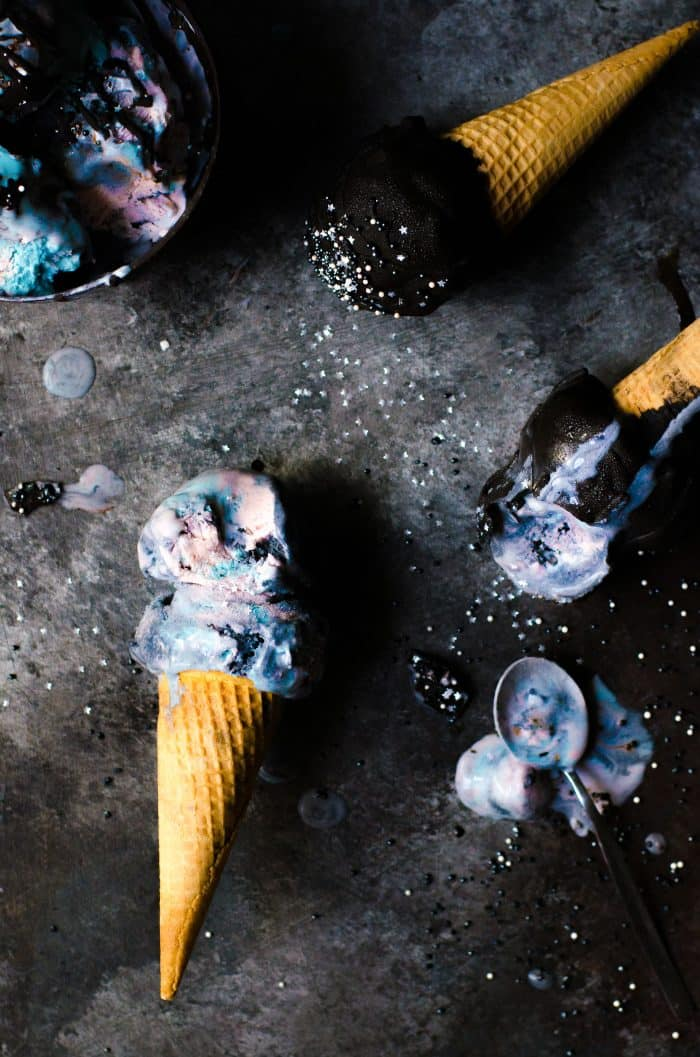 No churn Galaxy Ice cream - made with absolutely no food coloring and with fresh fruits, butterfly pea flower extract, and activated coconut charcoal. This mixed berry lemon ice cream is as delicious and magical as it looks!