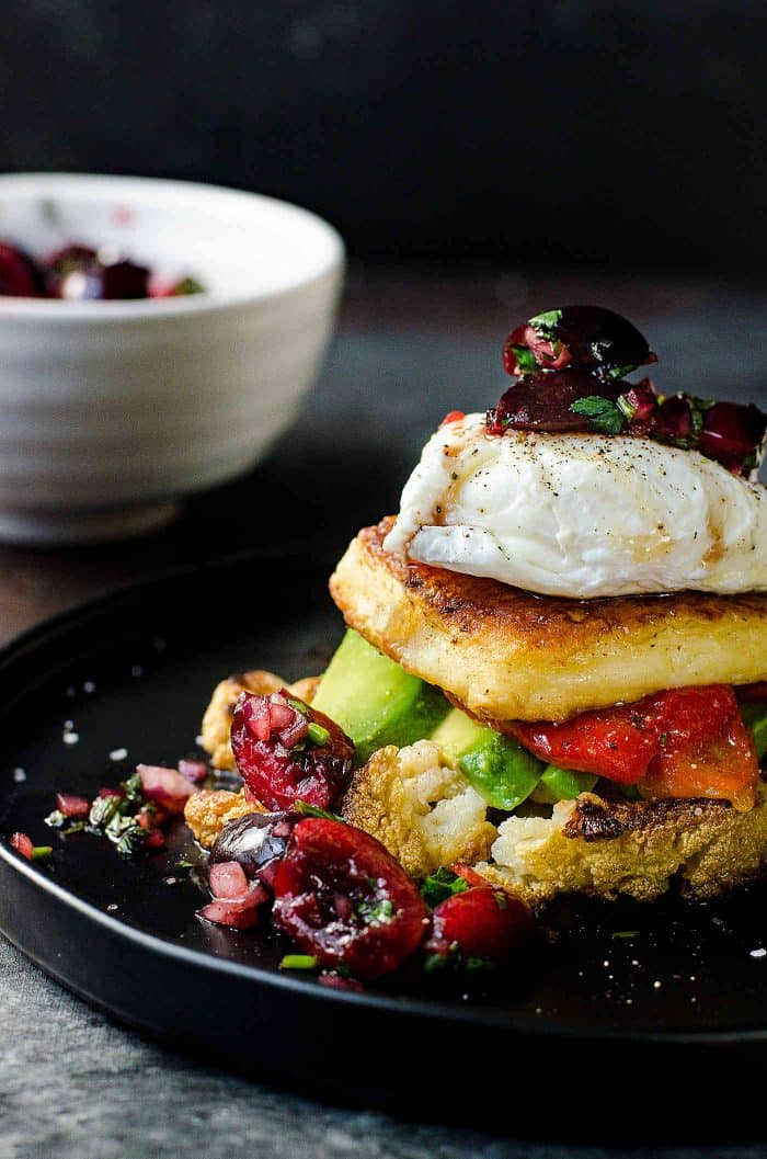 Roasted Cauliflower, Avocado and Fried Halloumi Breakfast with Cherry Salsa -A gluten free breakfast or brunch mealwith tons of delicious flavors! A delicious salty and soft slice of fried Halloumi served with creamy avocados, delicious cauliflower and red pepper and a fresh and herby cilantro mint cherry salsa!