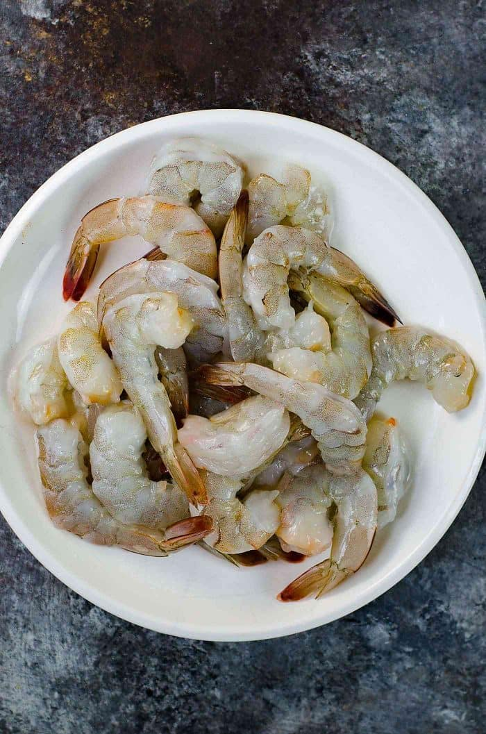 How to clean Shrimp - Unpeeled, cleaned shrimp with the tail on.