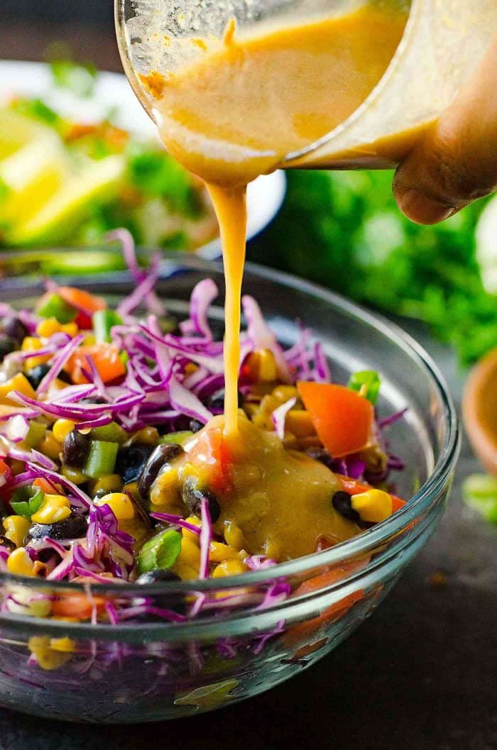 Rainbow blueberry coleslaw with a fresh almond honey mustard dressing! It's a creamy, nutty dressing with no mayonnaise, perfect for any salad!