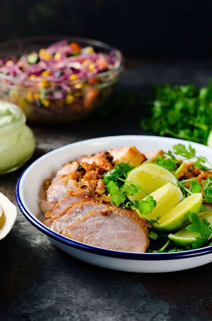 Roasted Pork Tacos  with blueberry coleslaw - Tacos with tender pieces of roasted applewood smoked bacon Pork loin, and topped witha a fresh and light blueberry rainbow coleslaw with an almond honey mustard dressing (no mayonnaise), and an Jalapeno avocado crema. A meal that's ready in 30 minutes with some life saving shortcuts!