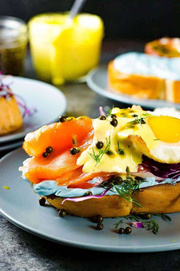 Smoked Salmon Toasts with Passion fruit Hollandaise Sauce - A fun and colorful breakfast or brunch recipe for the whole family. All natural rainbow colored twist for Salmon Toasts, topped with a Blender made Passion fruit Hollandaise Sauce.