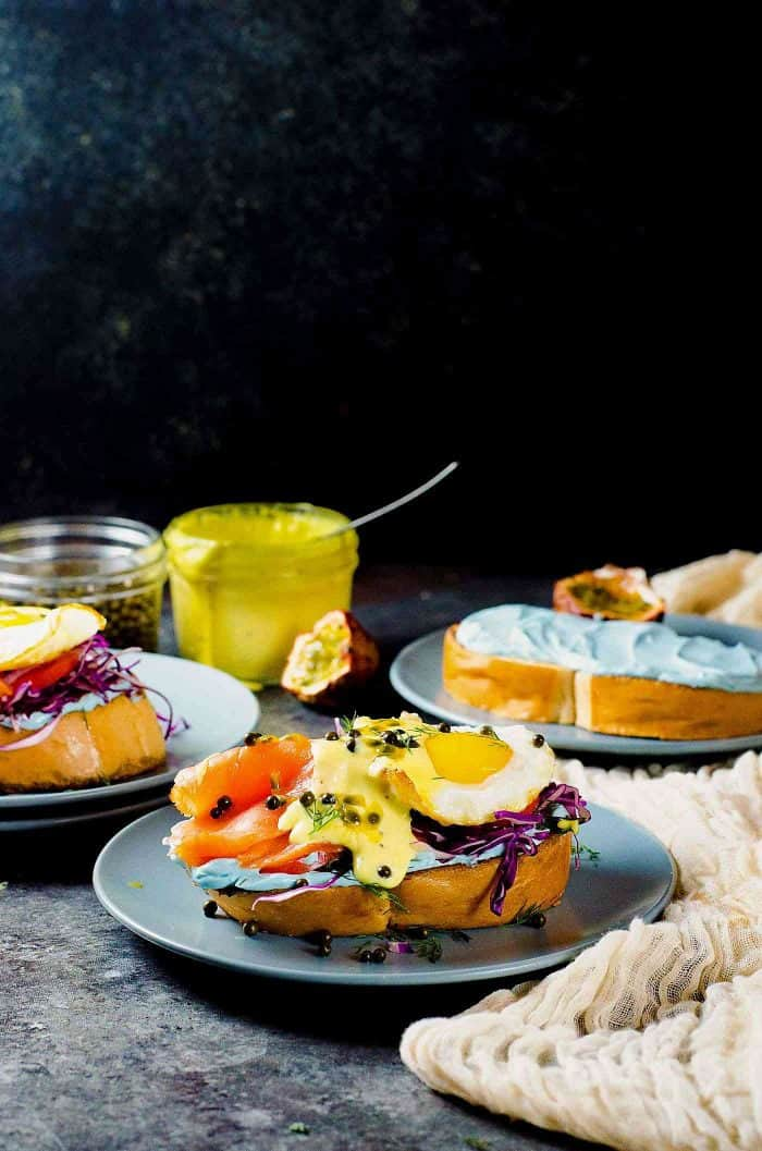 Smoked Salmon Toast with Passion fruit Hollandaise Sauce - A fun and colorful breakfast or brunch recipe for the whole family. All natural rainbow colored twist for Salmon Toasts, topped with a Blender made Passion fruit Hollandaise Sauce.