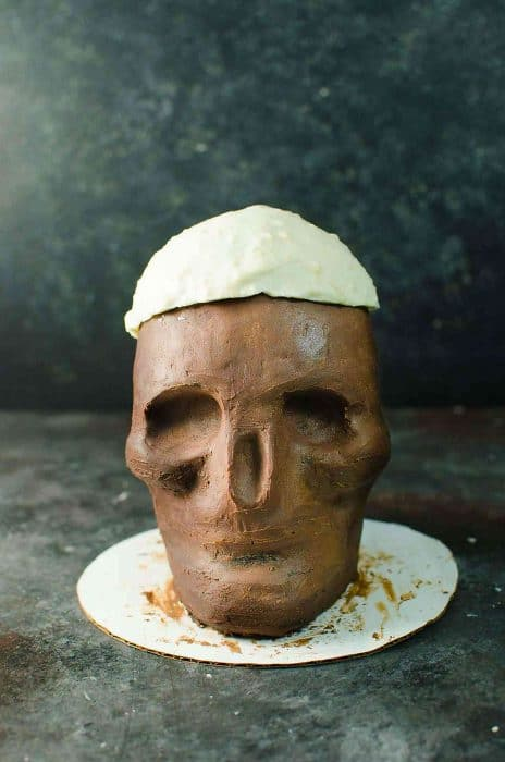 Boozy Chocolate Skull Cake with Strawberry Jello Brain and Red Velvet blood sauce - Perfectly gruesome and delicious Halloween Cake! Melt the White chocolate skull to reveal the secret Jello Brain hidden inside!