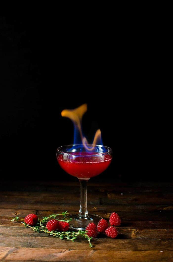 Flaming Dragon's Blood Cocktail - Thyme and Raspberry Daiquiri for parties. A showstopping flaming Halloween Cocktail made with raspberries and thyme.
