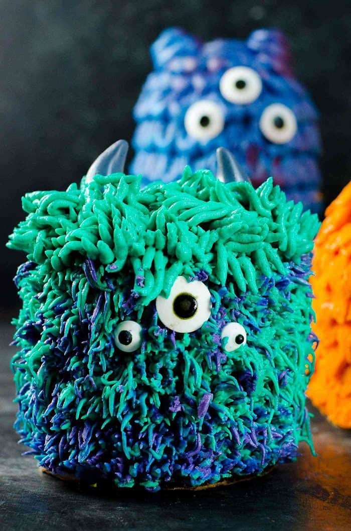 Teal Monster with Long fur hair and short fur body. Inspired by Sully from Monsters Inc. Mini Monster Cakes (Halloween Cakes) - A cake recipe for fudgy Chocolate Sheet cake and a full step by step tutorial to make 5 mini monster cakes that are perfect for Halloween Parties or Monster themed parties.