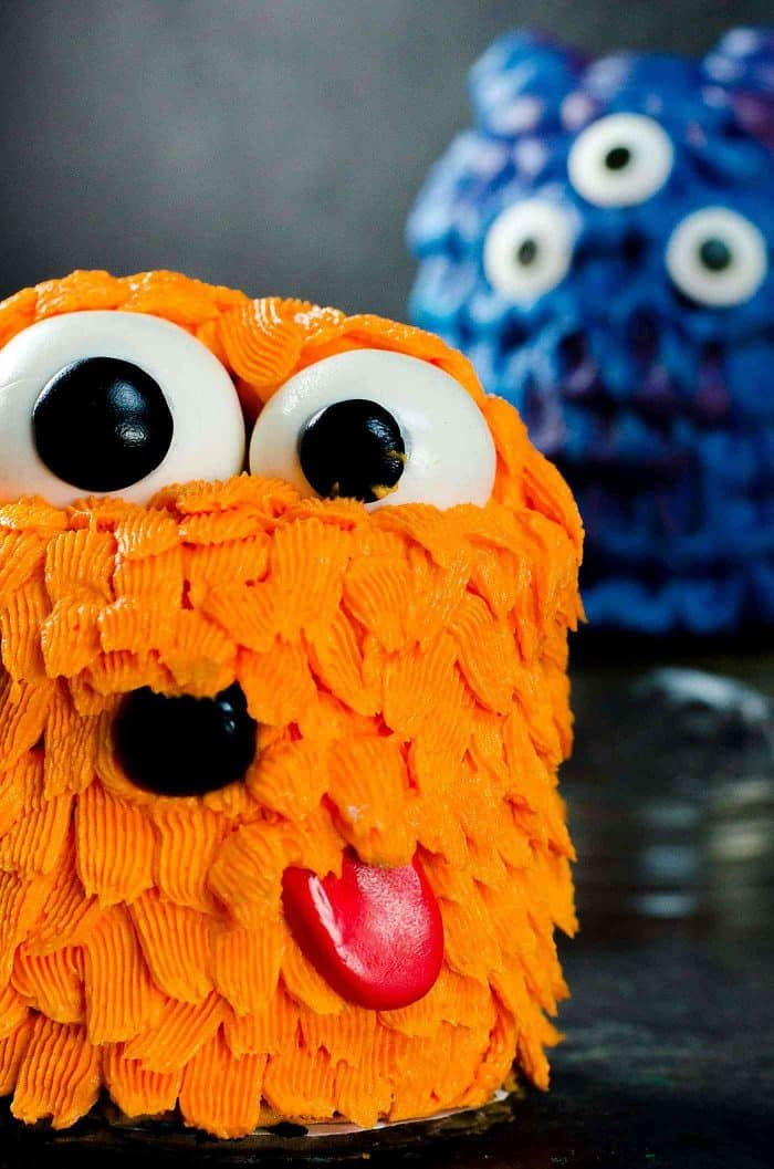Orange Pet monster - Mini Monster Cakes (Halloween Cakes) - A cake recipe for fudgy Chocolate Sheet cake and a full step by step tutorial to make 5 mini monster cakes that are perfect for Halloween Parties or Monster themed parties.
