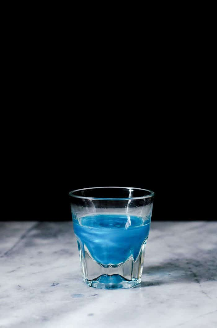 Phoenix Cocktail - Butterfly pea infused Color changing shimmery Gin that is used for this cocktail