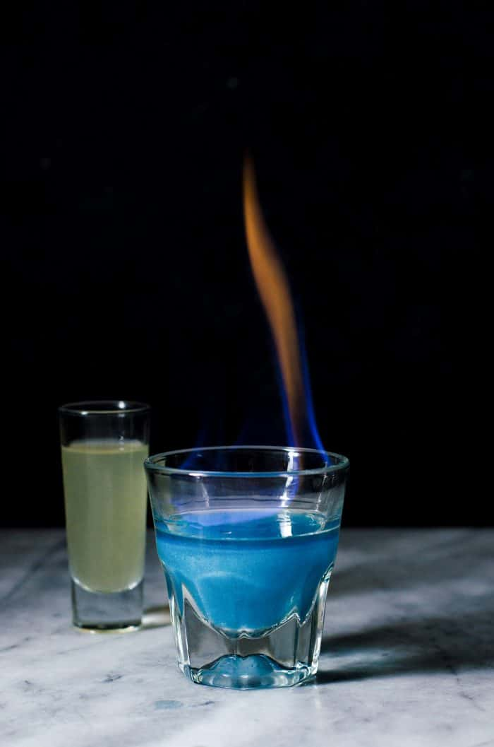 Phoenix Cocktail - An Gin and Elderflower Cocktail that is a Color Changing Shimmery Cocktail! Made with Butterfly pea Flower infused gin anda fruity, tangy, floral and sweet lemon Elderflower syrup.