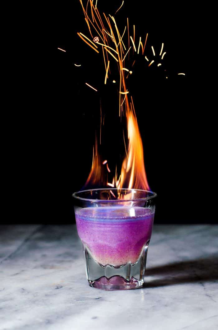Phoenix Cocktail - An Gin and Elderflower Cocktail that is a Color Changing Shimmery Cocktail! Made with Butterfly pea Flower infused gin and a fruity, tangy, floral and sweet lemon Elderflower syrup.