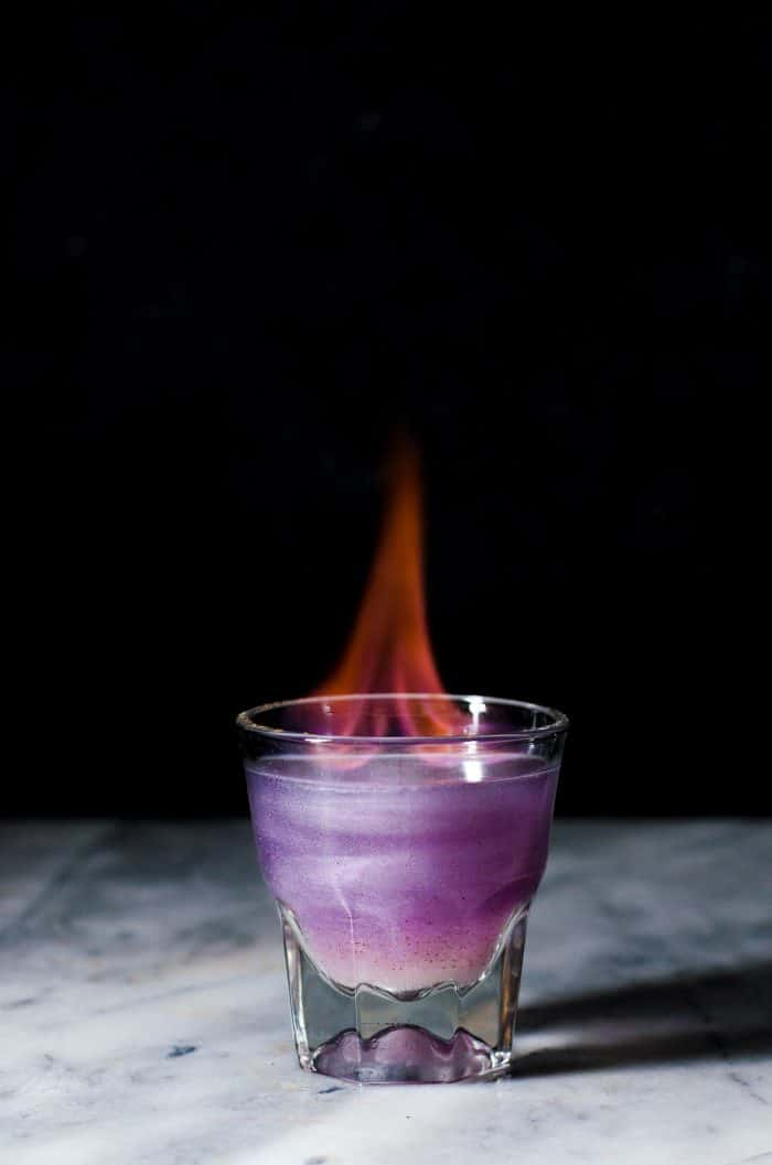 Phoenix Cocktail - An Elderflower and Gin Cocktail that is a Shimmery Color Changing Cocktail! Made with Butterfly pea Flower infused gin and a fruity, tangy, floral and sweet lemon Elderflower syrup.