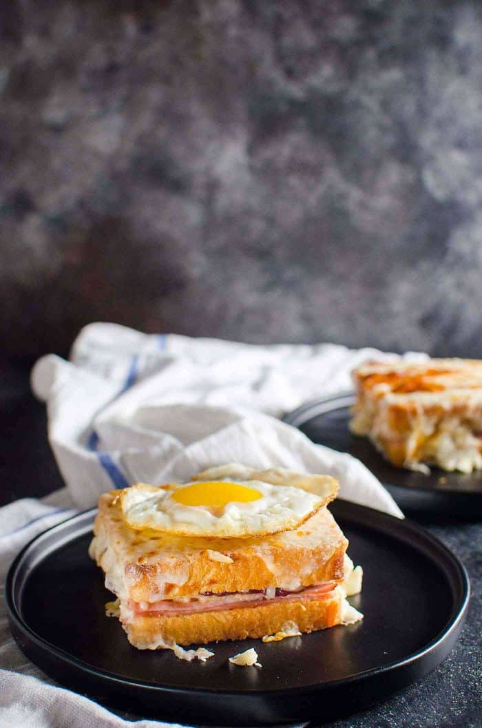 Turkey Croque Monsieur or Turkey Croque Madame - A delicious twist on the classic French sandwich. The perfect way to use up Thanksgiving leftovers too. A cheesy Ham and cheese sandwich with cranberry mustard sauce and Turkey, slathered in Bechamel Sauce.