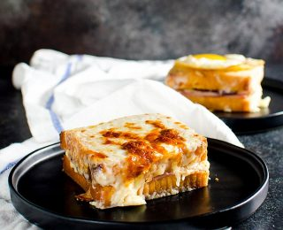 Turkey Croque Monsieur or Croque Madame - A delicious twist on the classic French sandwich. The perfect way to use up Thanksgiving leftovers too. A cheesy Ham and cheese sandwich with cranberry mustard sauce and Turkey, slathered in Bechamel Sauce.