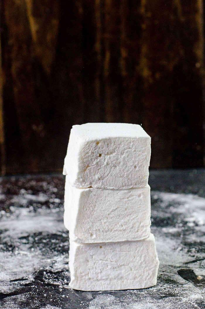 How to make marshmallows - homemade marshmallows stacked on top of each other.