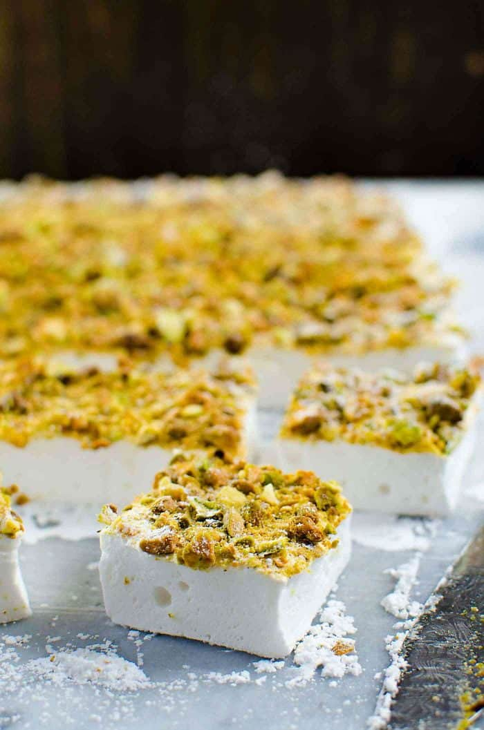 Orange blossom Marshmallows with Pistachios - Fluffy, melt in your mouth homemade Marshmallows made with no corn syrup and so easy to make too! Read the tips on how to make, and cut perfect marshmallows every single time.
