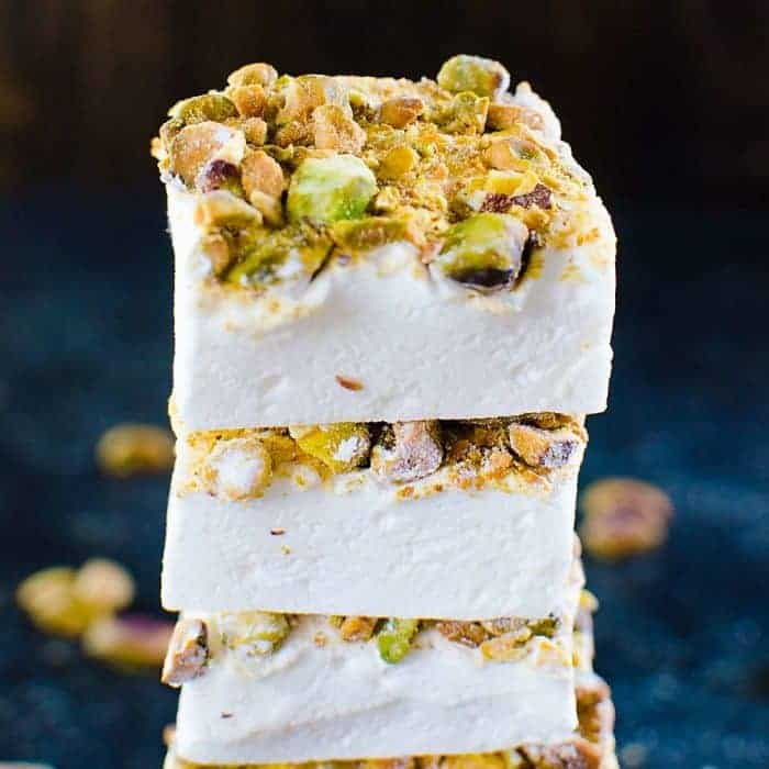 Orange blossom Marshmallows with Pistachios - Fluffy, melt in your mouth homemade Marshmallows made with no corn syrup and so easy to make too! Flavored with exotic orange blossom water and roasted pistachios, these are perfect for gift giving for Christmas or any holiday.