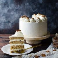 Spiced Bourbon Butter Pecan Cake with Brown Butter Maple Frosting - A fall cake that's perfect for thanksgiving dessert.  Flavors of a pecan pie in a cake with nutty, sweet and spiced flavors.