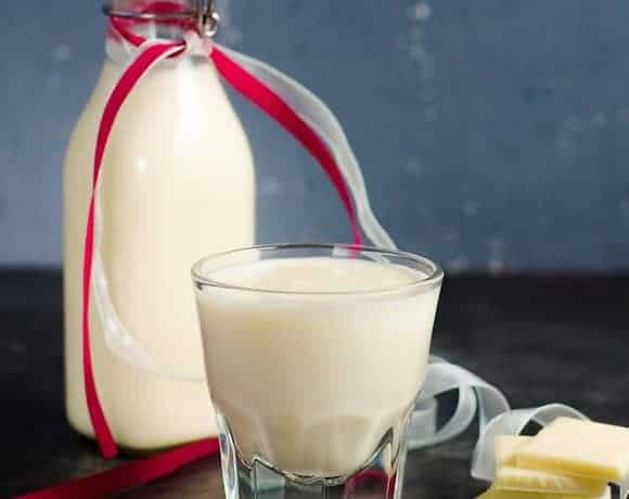 The BEST homemade white chocolate liqueur that is so easy to make, and absolutely delicious with extra white chocolate flavor! It's NOT sickly sweet, but still has the creamy taste of white chocolate! Far better than store bought too.