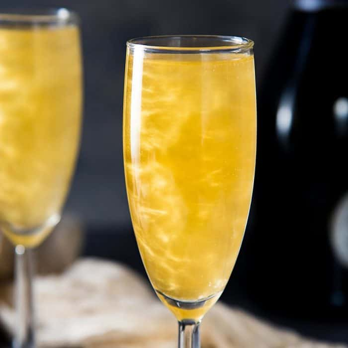Gold Shimmery Champagne Cocktail - an easy shimmery New Year's Eve Cocktail that is perfect as any celebration cocktail. Get the recipe for this floral and bubbly, elderflower champagne cocktail with non alcoholic options too.