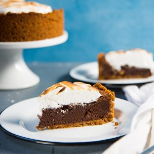 Fudgy S'mores Brownie Pie - A Butterscotch crust, a fudgy chocolate brownie filling and topped with a meringue topping! One of my favorite recipes from my cookbook - Secret Layers Cake!