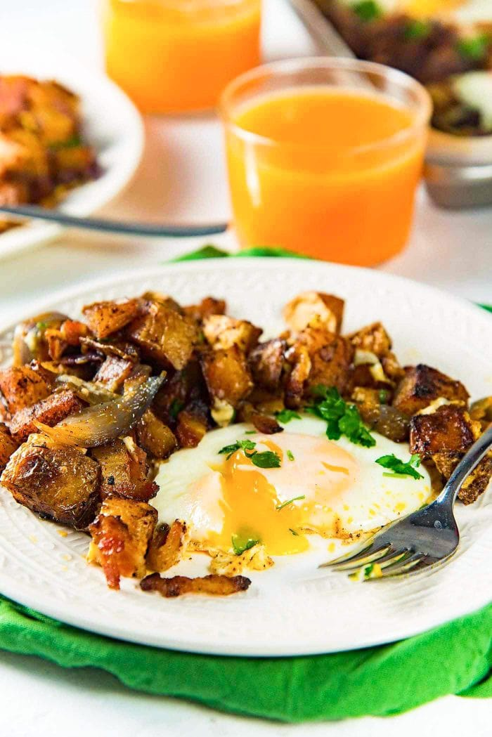 .Sheet pan Breakfast Potatoes with Bacon and Eggs - This oven roasted breakfast potatoes and eggs with crispy bacon bits, is all cooked in the same sheet pan so you can enjoy your weekend mornings without standing over the stove. With perfectly cooked eggs with a creamy runny yolk.