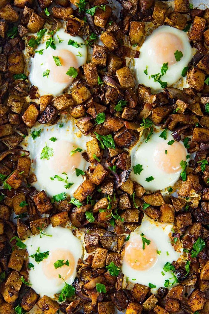 Sheet pan breakfast potatoes with bacon and eggs - Cook all the ingredients in the same sheet pan, so you can relax and let the oven make your breakfast on weekends. Plus with tips on how to make this for busy weekday mornings too.