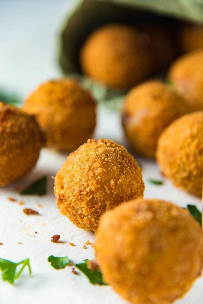Crispy Cheese Jalapeno Bacon Bites - The crispy cheese balls are coated in a crunchy panko crumb coating, and is the perfect texture for the gooey melted cheese center.