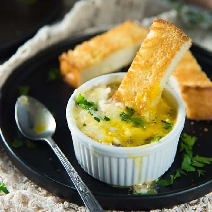 Creamy Gruyere and Mushroom Eggs en Cocotte -incredibly simple breakfast or brunch dish to prepare, but fancier and more flavorful than you could imagine! Baked eggs with a creamy spiced mushroom sauce and gruyere cheese.