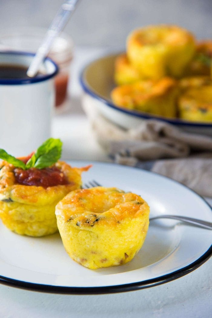 Pizza Egg Muffins - Serve with or without the marinara sauce on top. Perfect breakfast packed with flavor!