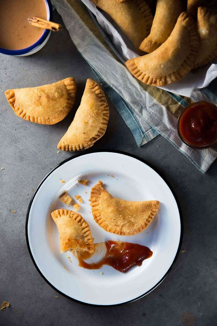 Sri Lankan Fish Patties - These fish empanadas are epic! A spicy fish filling inside perfectly flaky buttery crust. Perfect for snacking. Step by step instructions to make these Sri Lankan Patties