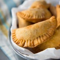 Sri Lankan Fish Patties - These fish empanadas are epic! A spicy fish filling inside perfectly flaky buttery crust. Perfect for snacking. Step by step instructions to make these Sri Lankan Patties. Freezer friendly too.