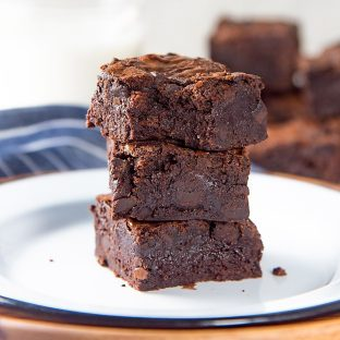 The Best Fudgy Chocolate Brownies - These fudgy brownies are made with cocoa powder with chunks of real chocolate in the brownies. With detailed tips on how to make perfect fudgy cocoa brownies.