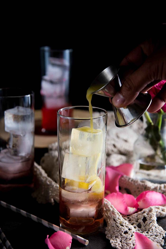 Ginger Rose Fizz - Pour the lemon juice into the glass over ice.