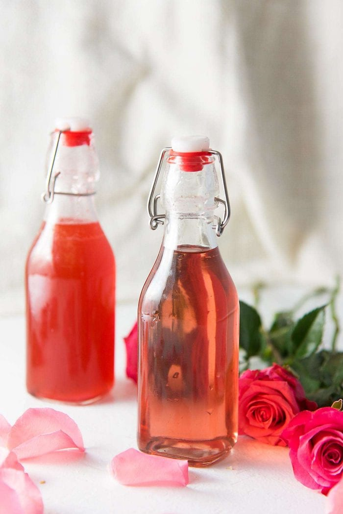 Learn how to make Rose syrup. Perfect for cocktails and other drinks. Made with rose water and can be naturally colored or colored with food coloring.
