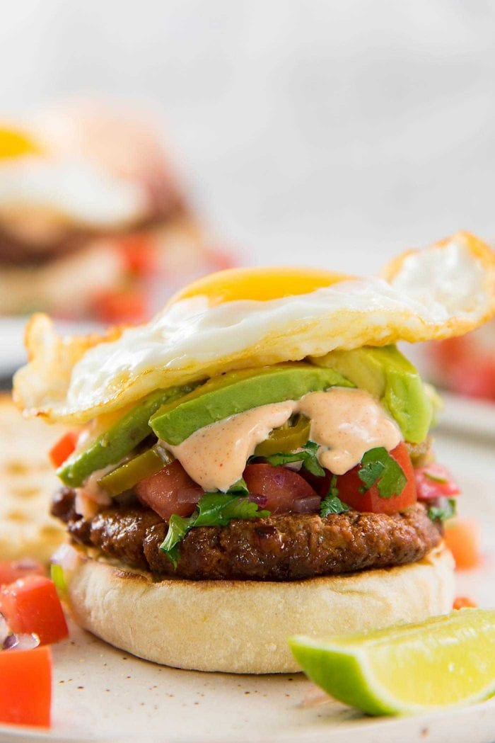 Breakfast Chorizo Burgers - Perfect hearty breakfast, or brunch with spicy chorizo burgers, pico de gallo and a fried egg!