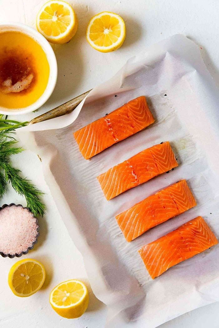 Buttery Lemon Slow Roasted Salmon with Lemon Butter Sauce - Pat dry salmon and cut it into portions. Prep the salmon to let it marinate for a few minutes.