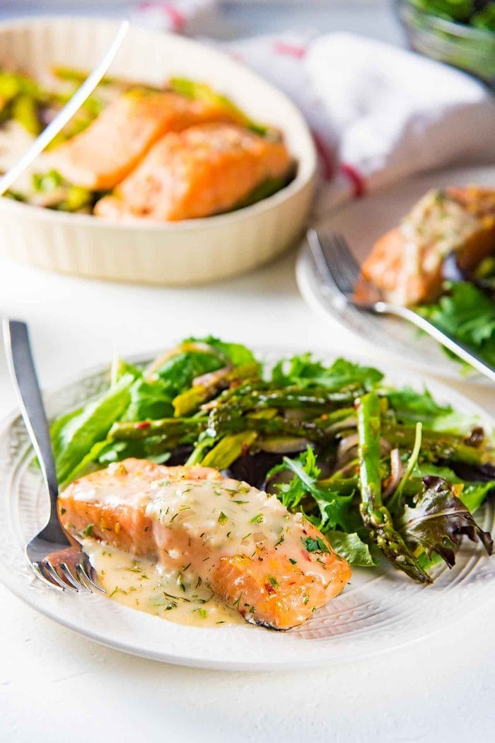 Buttery Lemon Slow Roasted Salmon with Lemon Butter Sauce - Perfectly cooked, juicy slow roasted Salmon with a buttery tangy sauce! Delicious and versatile for any meal and occasion.