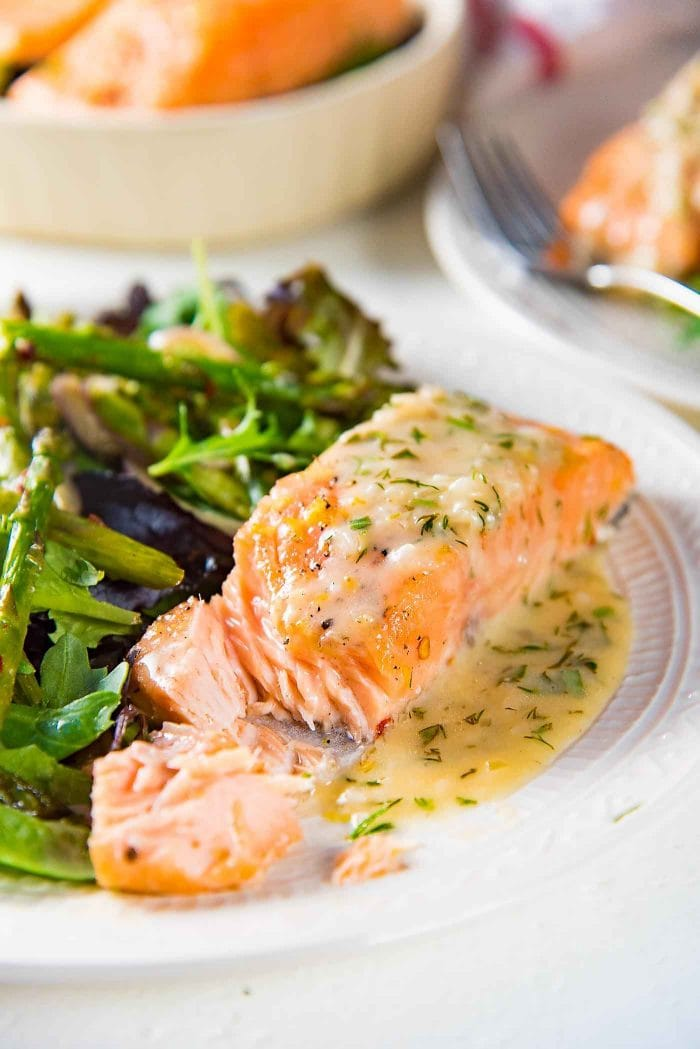 Buttery Lemon Slow Roasted Salmon with Lemon Butter Sauce - Perfectly cooked, juicy Salmon that you can serve a crowd! Easy to make and delicious!