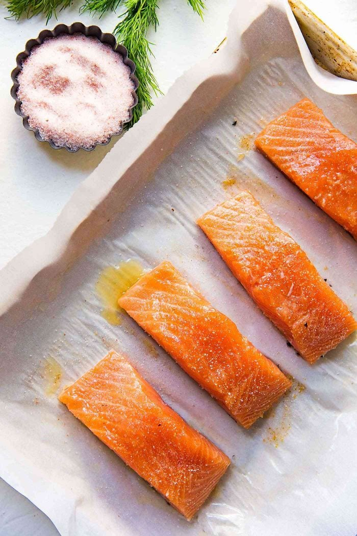 Buttery Lemon Slow Roasted Salmon with Lemon Butter Sauce - Drizzle lemon juice and sprinkle salt over the butter brushed Salmon and let it marinade for a few minutes.
