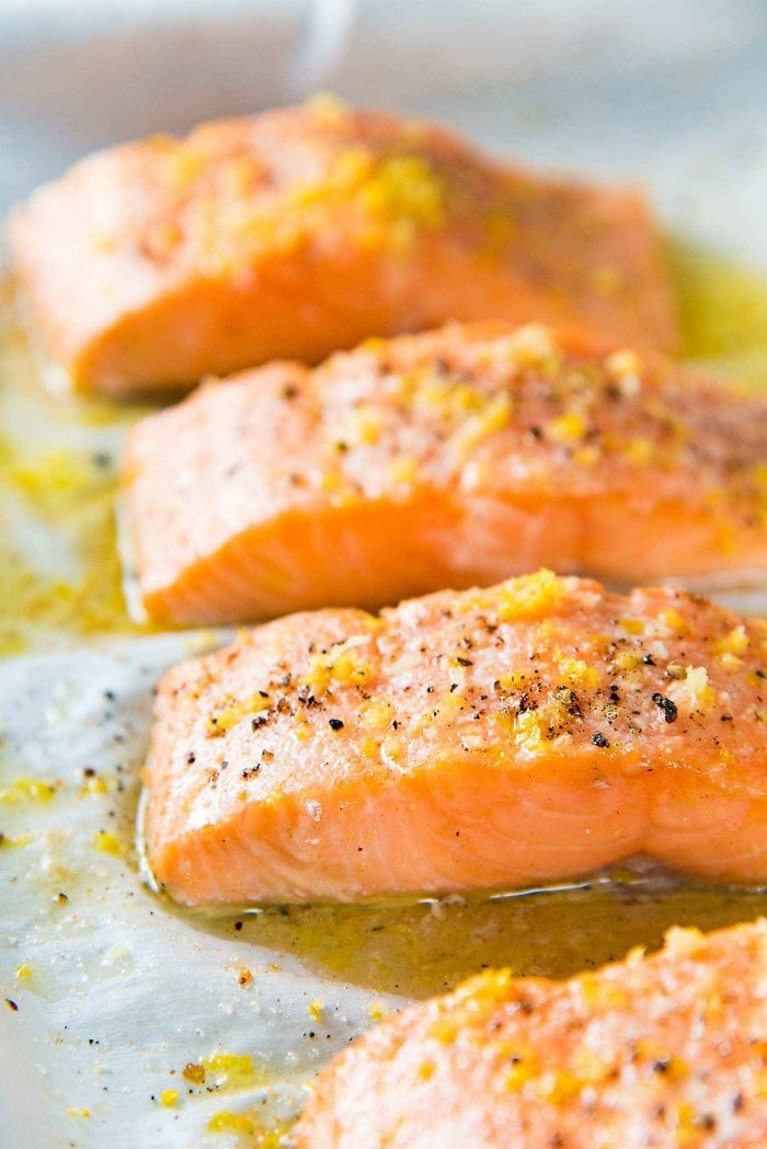 Buttery Lemon Slow Roasted Salmon with Lemon Butter Sauce - Add more butter, lemon zest and black pepper on top of the Salmon as soon as it's done cooking.