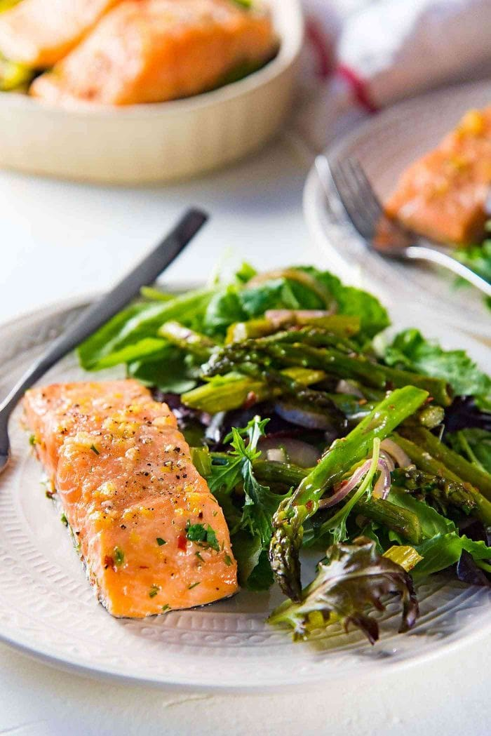 Buttery Lemon Slow Roasted Salmon with Lemon Butter Sauce - Get the tips for making perfect slow roasted Salmon. Serve it with a simple side of Salad and grilled vegetables (or Pan fried Asparagus).