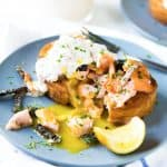 Egg in a hole with Salmon - Warm, buttery toast with a rich runny egg in a hole, and topped with salmon and crispy skin. A delicious brunch or breakfast recipe and a great way to use leftover salmon.