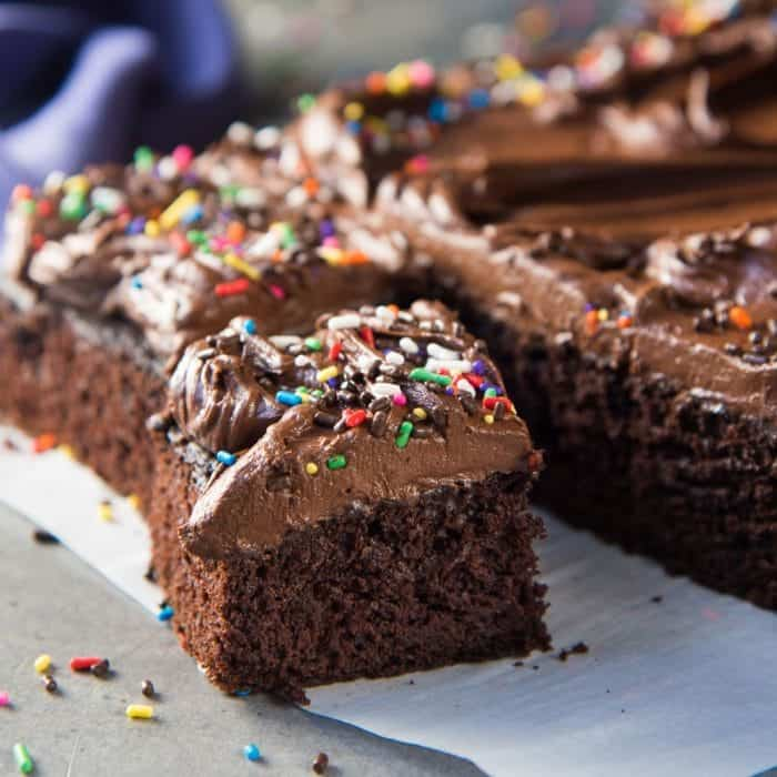 The Best One Bowl Chocolate Sheet Cake - A delicious fudgy chocolate sheet cake that is so easy to make. Top it up with a creamy chocolate buttercream frosting.