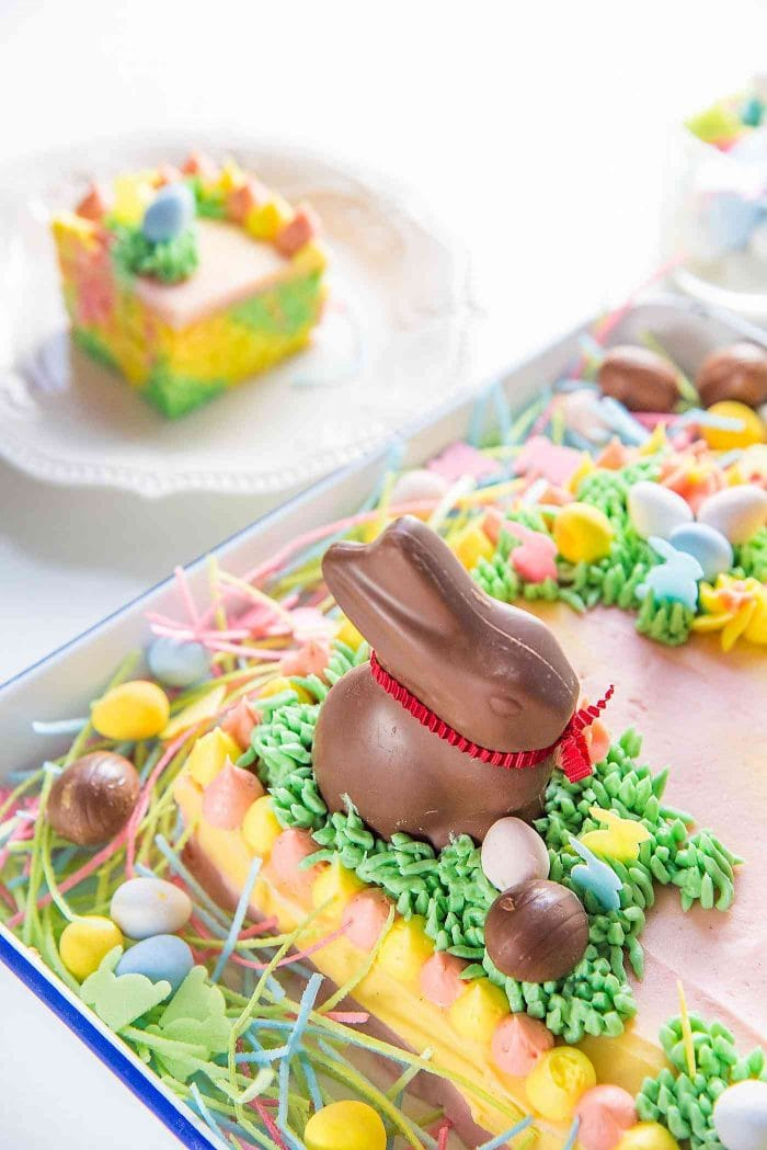 Pastel Easter Cake - This gorgeous Easter sheet cake is a cinch to decorate with buttercream decorations and your favourite Easter candy! It's perfect for a crowd and is the best butter and soft vanilla cake!