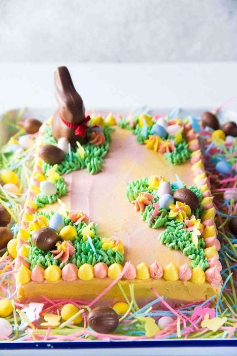 Pastel Easter Cake - This gorgeous Easter sheet cake is a cinch to decorate with buttercream decorations and your favourite Easter candy! It's perfect for a crowd and is the best buttery and soft vanilla cake!