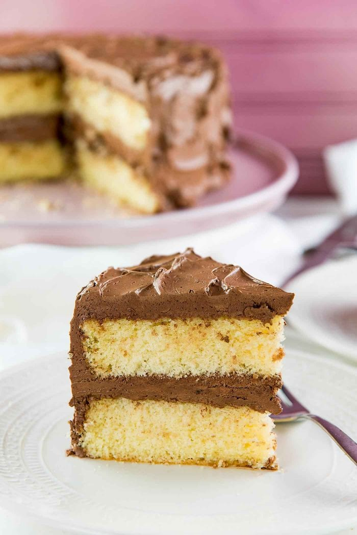 Best Vanilla Cake - Delightfully soft, buttery, classic vanilla cake with a creamy chocolate or vanilla frosting! With heaps of tips to get perfect cakes every single time.