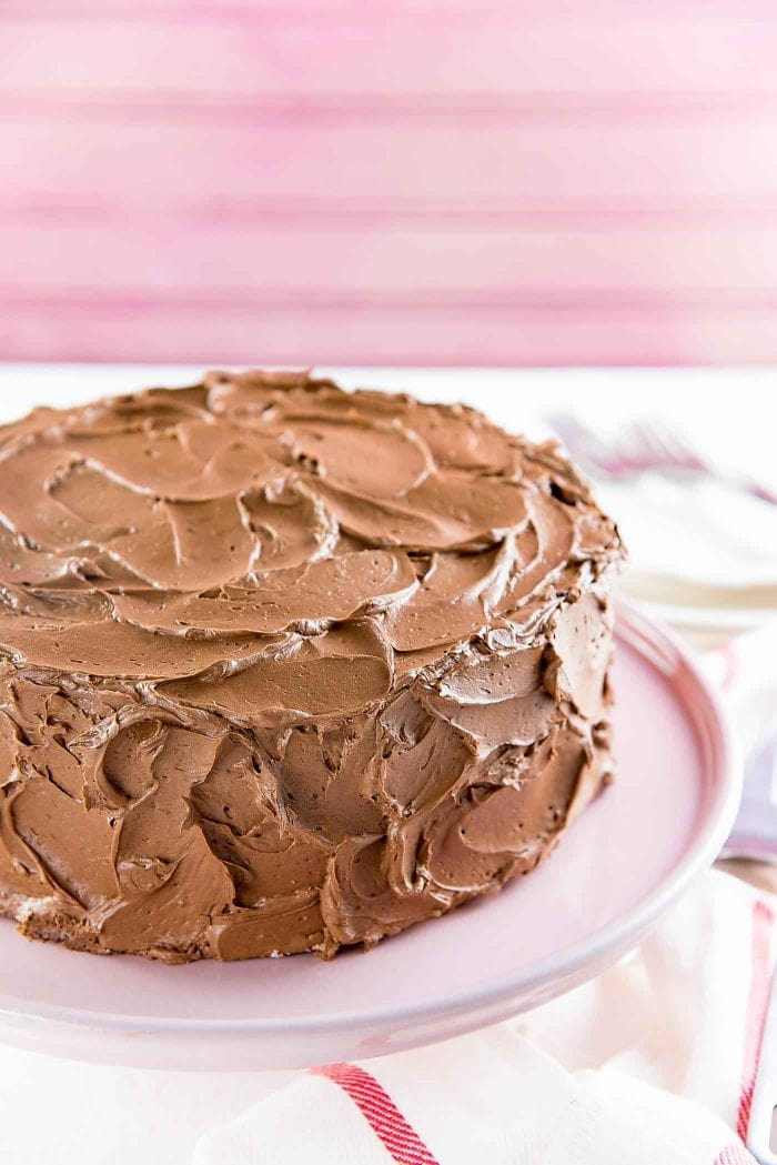 The Best Vanilla Cake - A vanilla cake with swirls of creamy chocolate frosting. Swirl the frosting for an old fashioned home-made look, OR smooth out the sides for a sleek look.